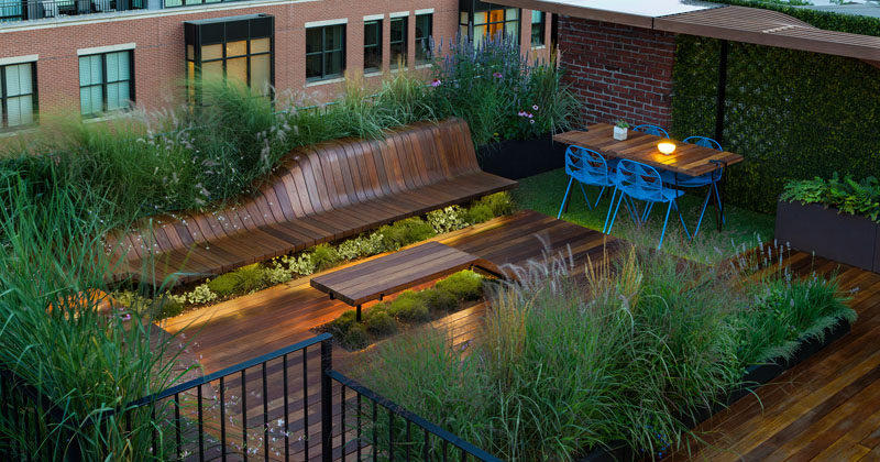 CONTEMPORIST: This Rooftop Deck Has Custom Designed Wood Benches Surrounded By Greenery