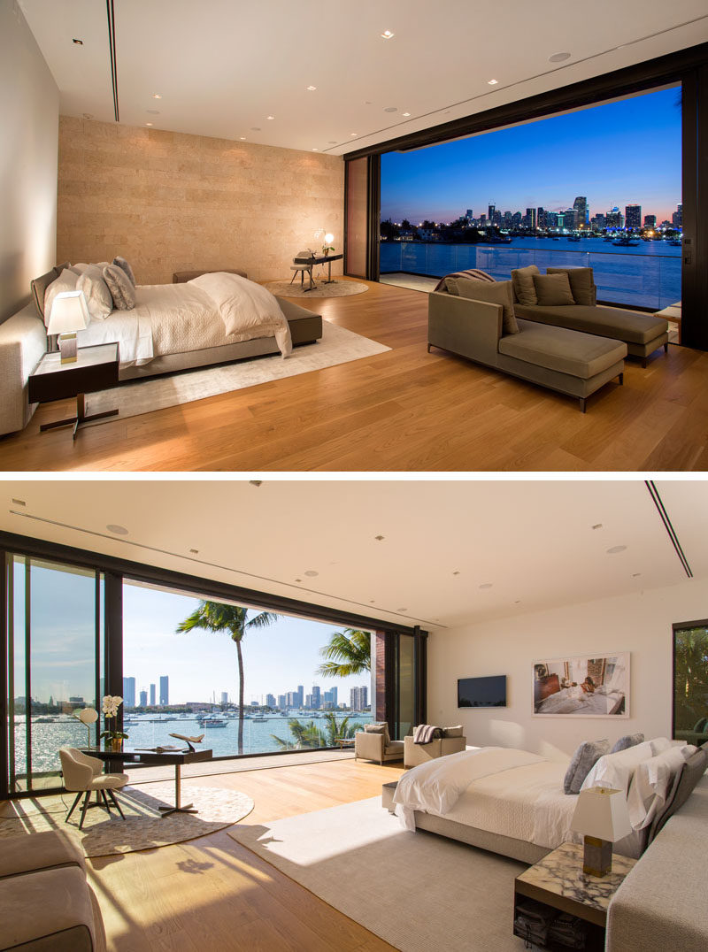 In this modern master bedroom suite there's a small home office area, a sleeping area and a lounge. The bedroom opens up to a private balcony, for even more living space. #MasterBedroom #MasterSuite #BedroomDesign