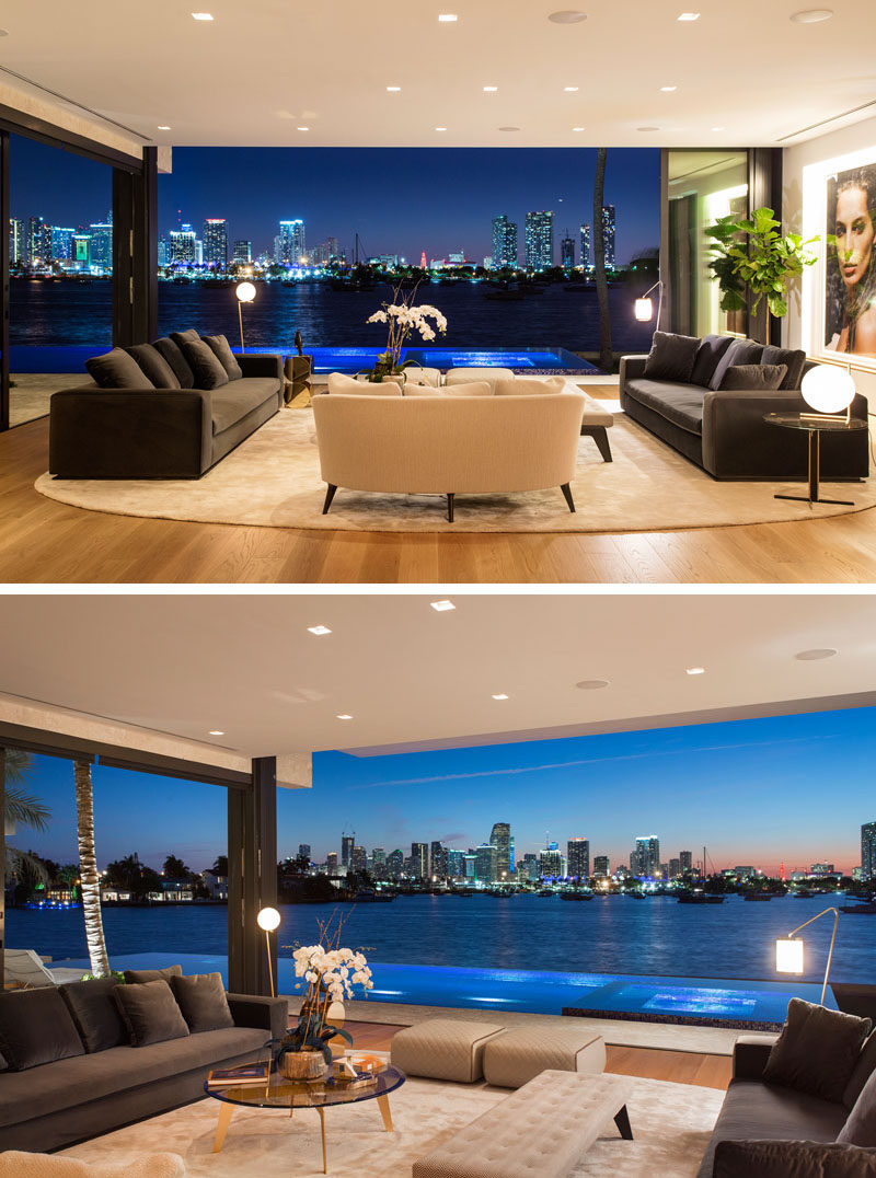 This modern living room is open to the swimming pool deck, and has been positioned to take advantage of the views of Downtown Miami and Biscayne Bay. #LivingRoom #RetractableWalls