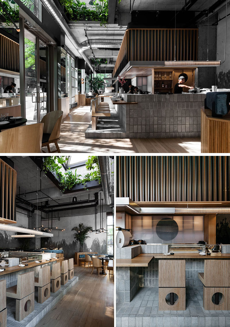 Translucent polycarbonate panels have been used to divide this modern restaurant kitchen from the sushi bar, creating a lantern effect at night and showing hints of the action happening within. #RestaurantDesign #SushiBar