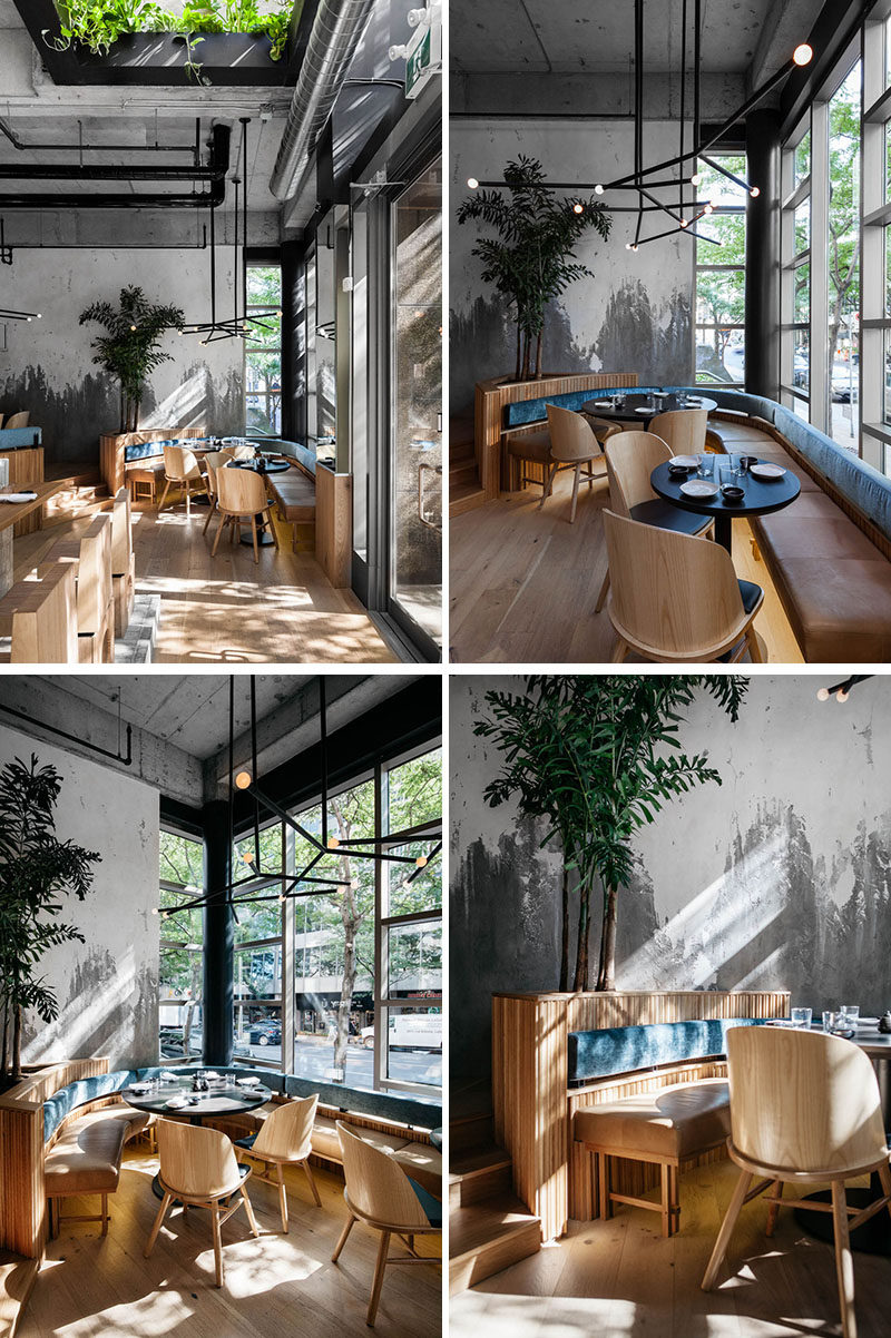 The seating along the front of this modern restaurant makes use of the natural light from the large windows, while curved banquette seating creates a casual and comfortable environment. #RestaurantDesign #RestaurantSeating #BanquetteSeating