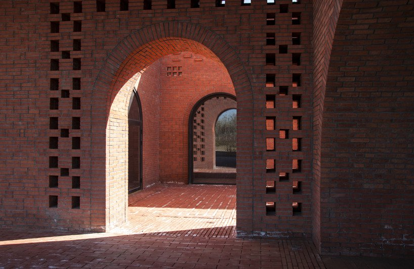 interval architects creates a botanic art center from a disused brick kiln in china
