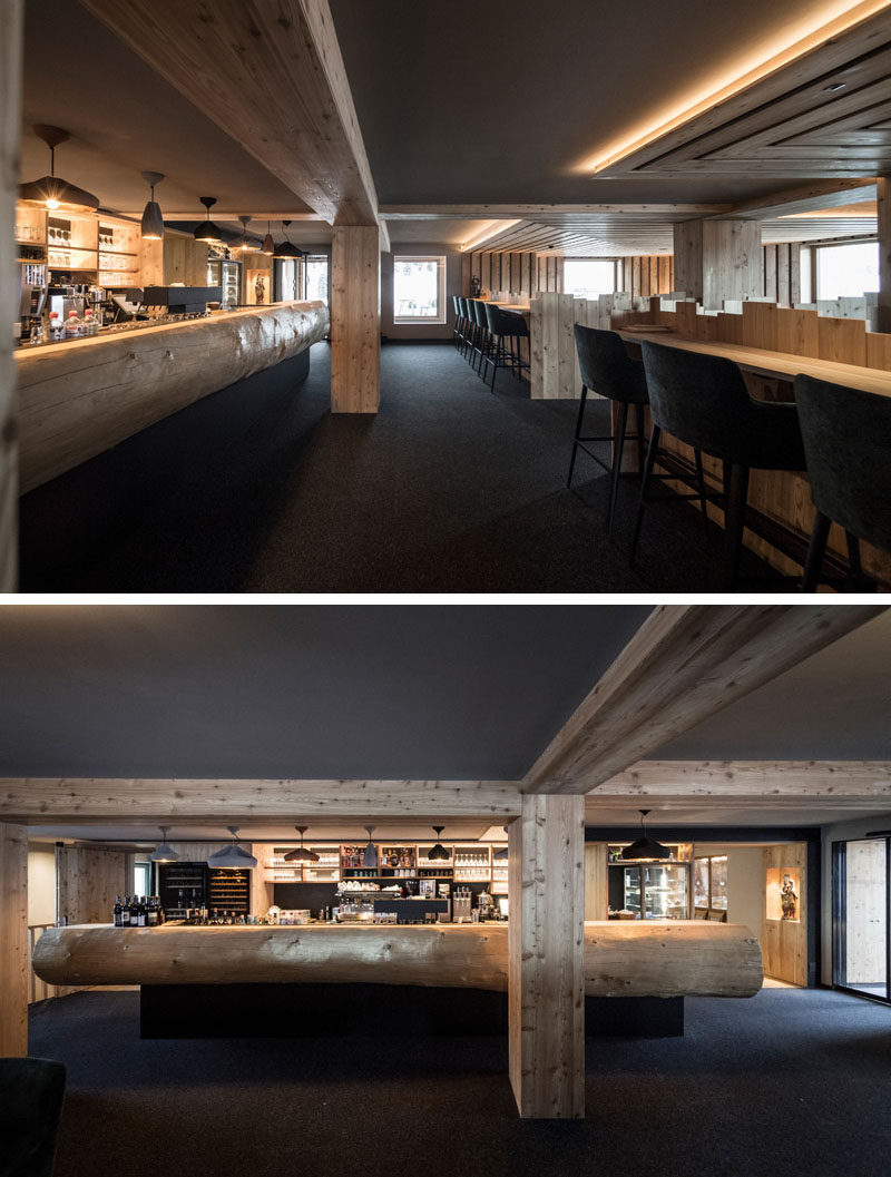 In this rustic modern hotel bar, there's a huge fir tree-trunk that has been repurposed into the counter. #HotelBar #InteriorDesign