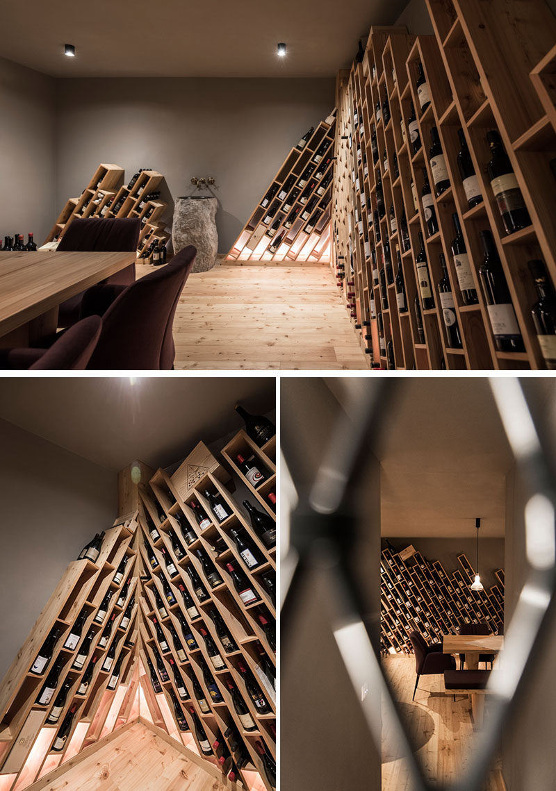 The design of this hotel's wine cellar is inspired by the mountains, and has wood shelving installed on an angle, with compartments for individual bottles of wine. #WineCellar #WineStorage