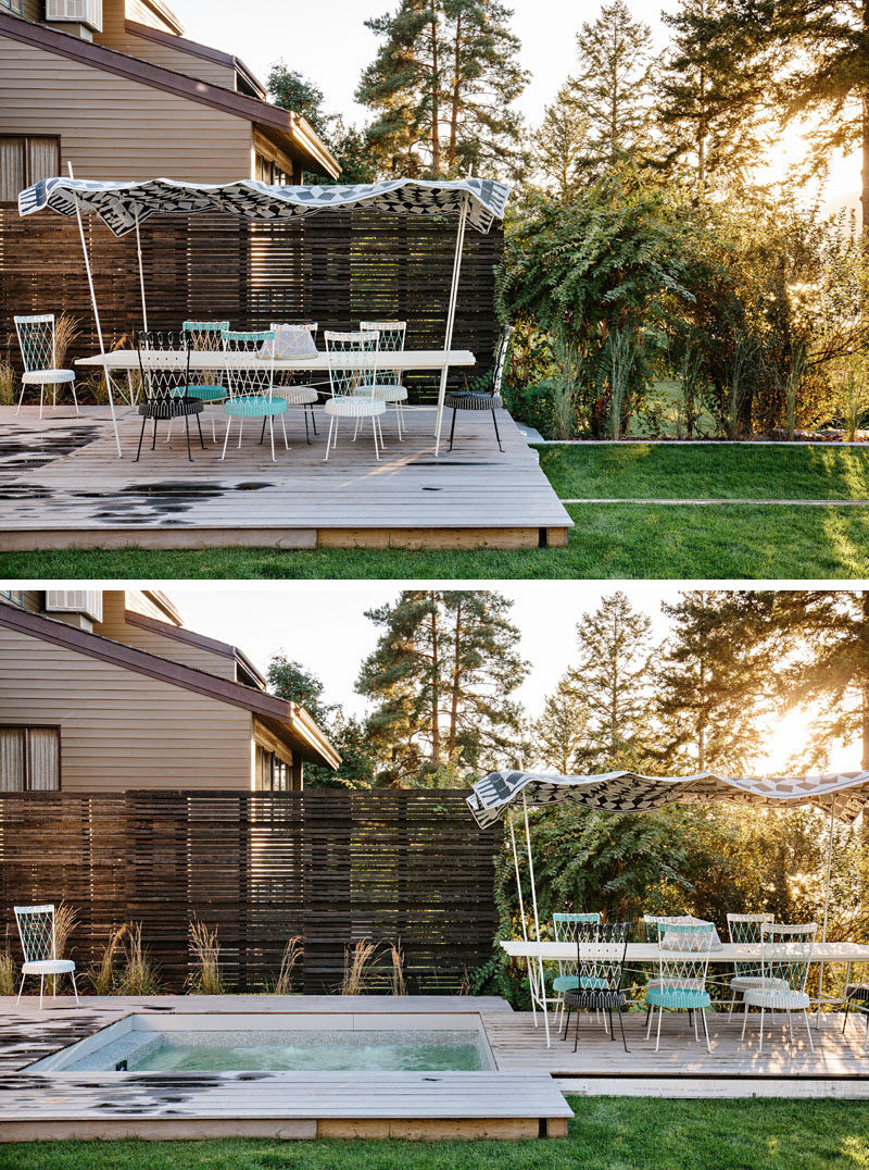 The deck of this modern outdoor space can slide along rails to reveal a hidden hot tub. #HotTub #Deck #OutdoorDining