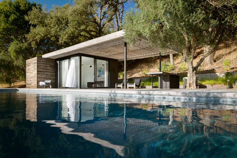 RO|ROCKETT DESIGN have completed a modern pool house as part of a rustic retreat for a couple in Geyserville, California. #PoolHouse #ModernArchitecture #SwimmingPool