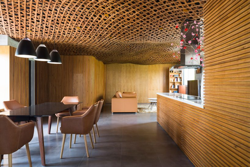 CTA tops vietnam apartment with 'cloud' of interlaced wood on its ceiling