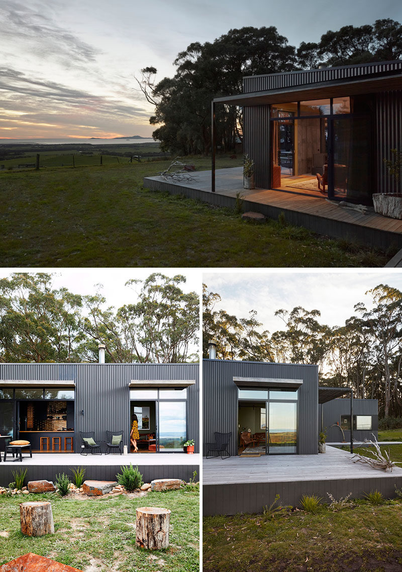 This modern Australian house features partially a covered porch, that's covered in Woodland Grey Colorbond cladding, timber, and natural materials and colors throughout the project. #ModernArchitecture #HouseDesign #Porch