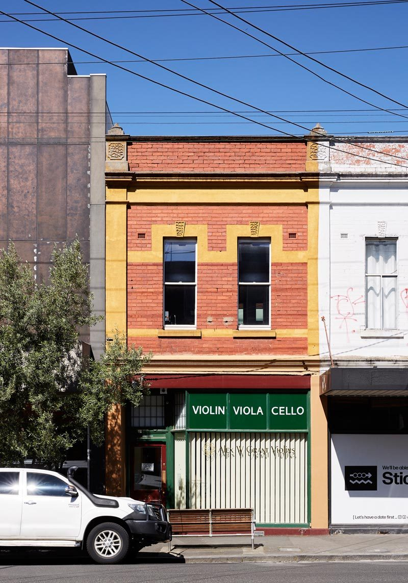 Tsai Design have completed the renovation of a rundown kitchen, living room, and bedroom that's located above their client's specialist violin sellers and repairers shop in Melbourne, Australia. #BrickFacade