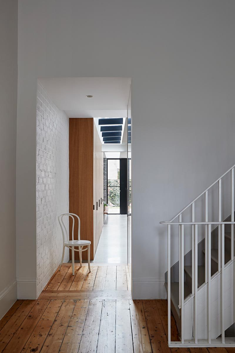Studio Tom has transformed a general store in Melbourne, Australia, into a modern house for a Melbourne couple and their two young daughters. #HouseExtension #WhitePaintedBrick #WoodFloors