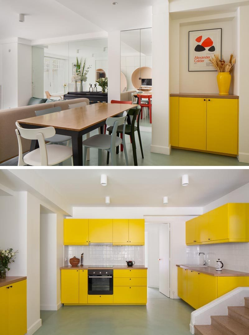 Throughout this modern apartment, bold colors were introduced to compensate for the lack of light in the apartment, like the bright yellow that's been used in the dining area and the kitchen. #YellowKitchenCabinets #YellowCabinetry