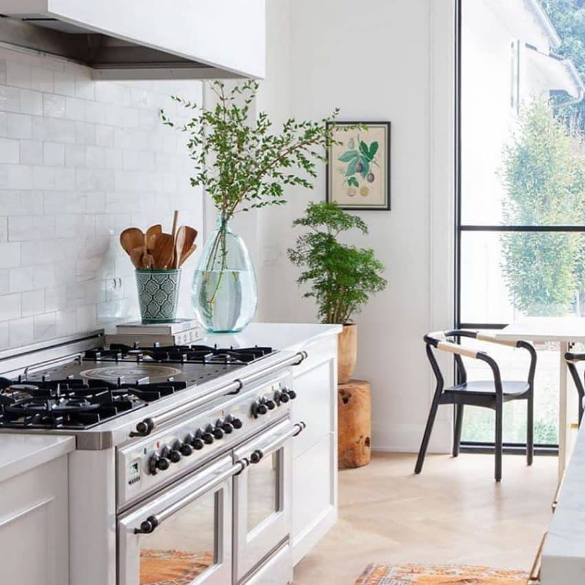 With a tiled splashback and floor-to-cei...