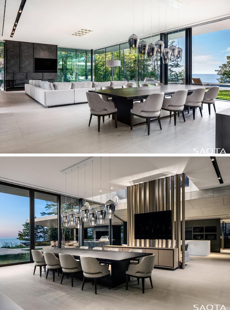 This modern lake house has an open plan living room and dining room that take advantage of the views with floor-to-ceiling glass walls and sliding doors. #LakeHouse #ModernLivingRoom #ModernDiningRoom #OpenPlanInterior #GlassWalls