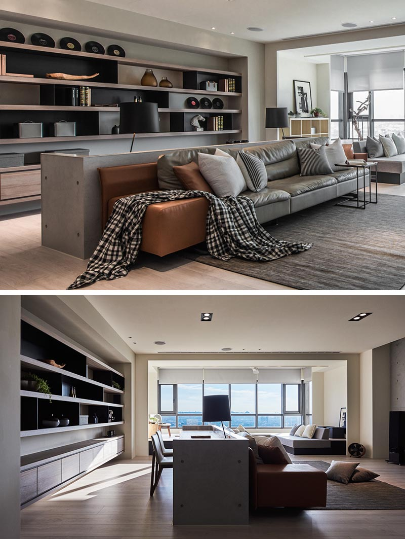 Located behind the couch, the home office is defined by a concrete border, that sits slightly higher than the furniture. #HomeOffice #OpenPlanLivingRoom #WorkStation #InteriorDesign #Interiors