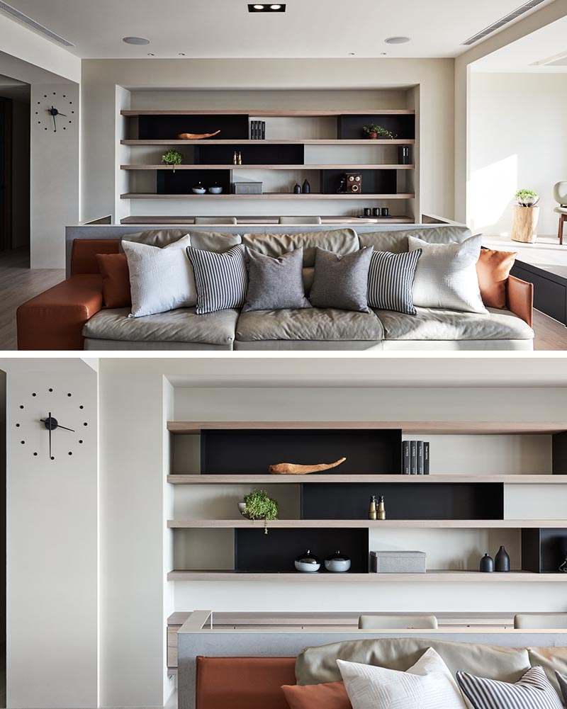 Wood and metal shelving and cabinetry has been added into an alcove behind a desk, creating a place for displaying decorative objects or storing work related items. #Shelving #HomeOffice