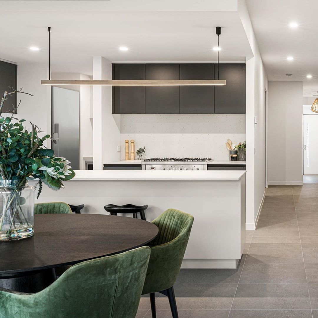 A stunning kitchen and dining area by @c...