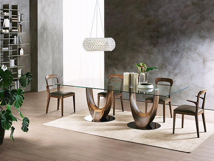 Extraordinary elegance and undulating shapes for the Axis table and the Gaya cha...