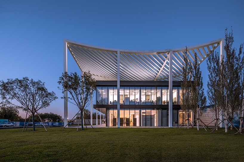 powerhouse company tops reception center for new city district in tianjin with 'paper roof'