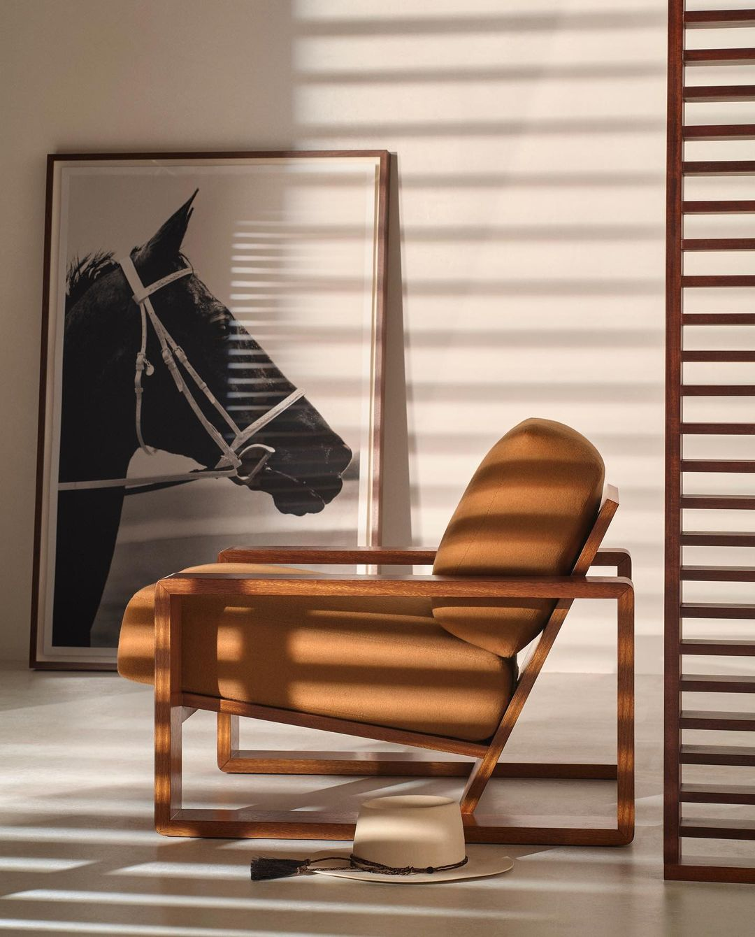The RL Lounge Chair offers an architectural silhouette.