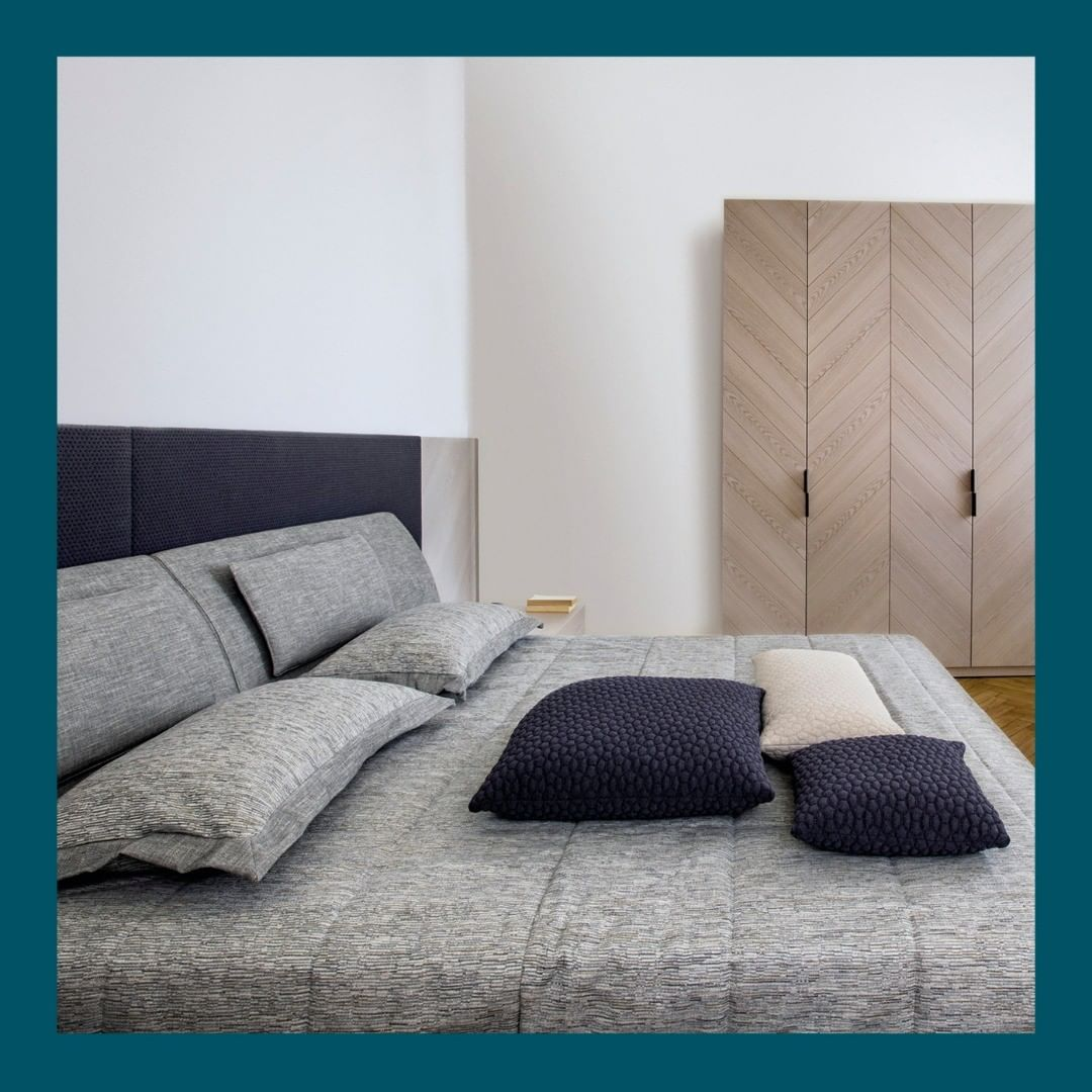 An upholstered bed with a long or short ...