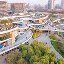 East Waterfront Retail Park and pedestrian bridge connection with the Cultural Park. Image © Yanlong Tong