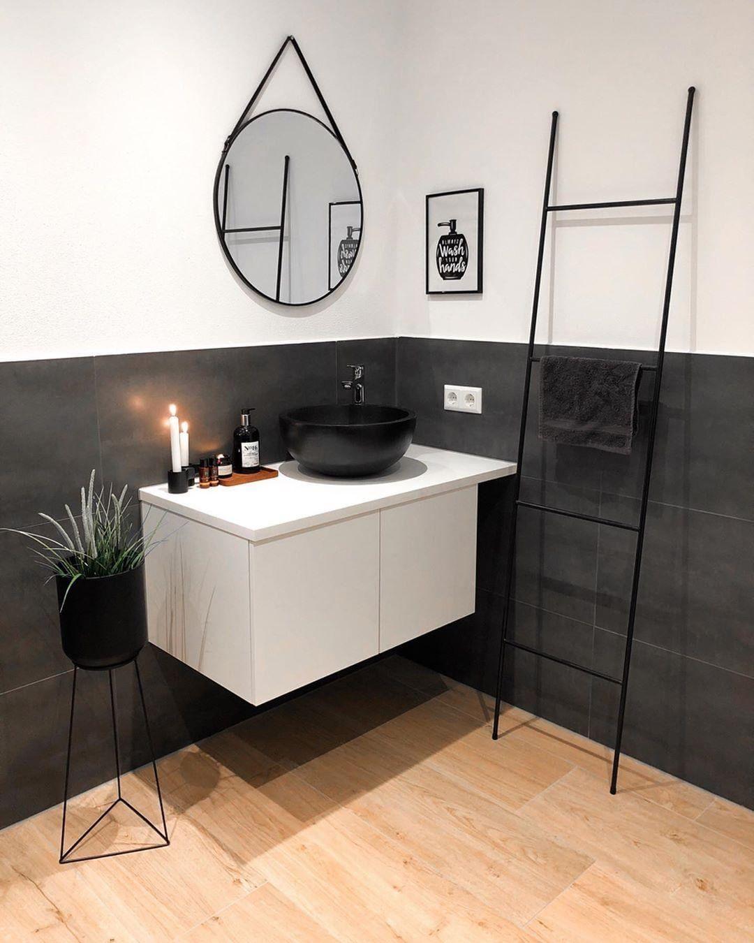 Bathroom featuring black-and-white furni...