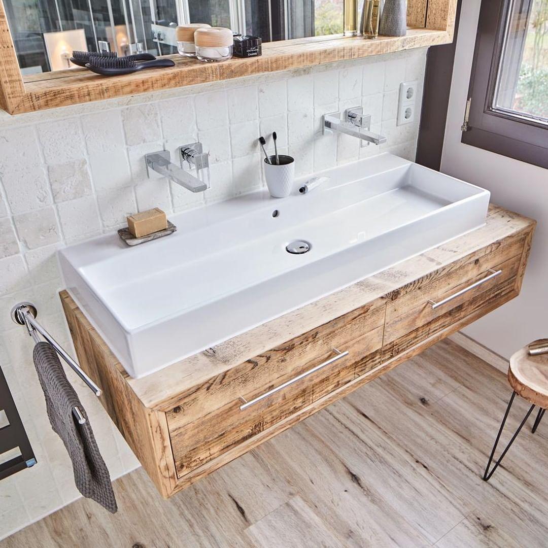 In a bathroom with elegant interiors, ha...