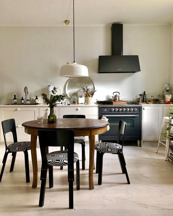 Mismatched furniture gives this open-pla...