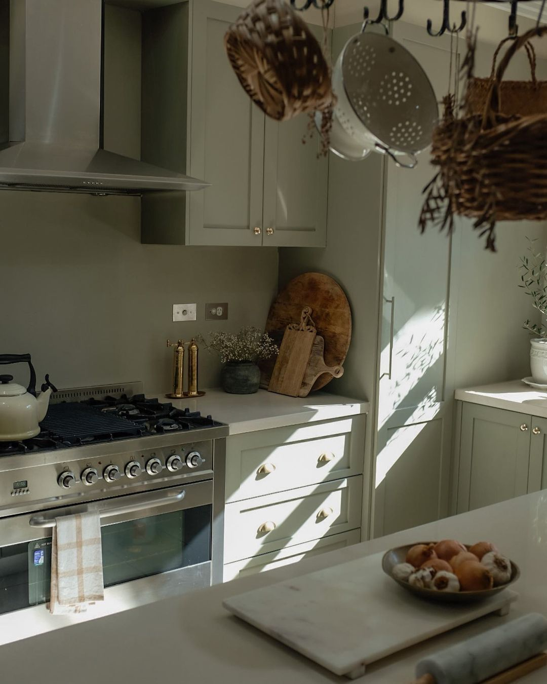 Morning sun.  This cosy kitchen featurin...