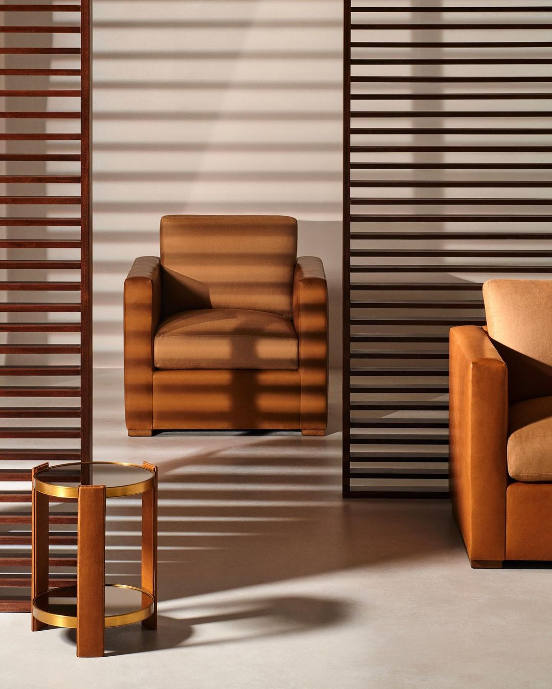 Upholstered in exquisite saddle leather, the handsome Addison Club Chairs and Da...