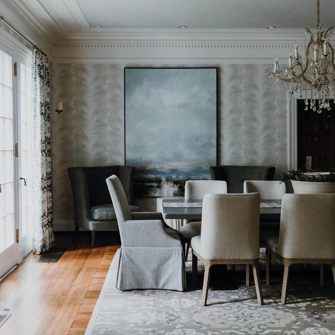 A serene dining room full of understated...